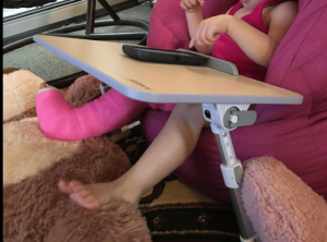 Toddler Using the Avantree Laptop Table on Couch