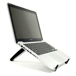 A Laptop on Top of the Tabletote Desk